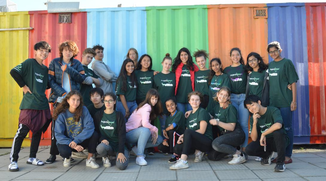 On a volunteer abroad program for high school students, teens relax and take a photo in South Africa.